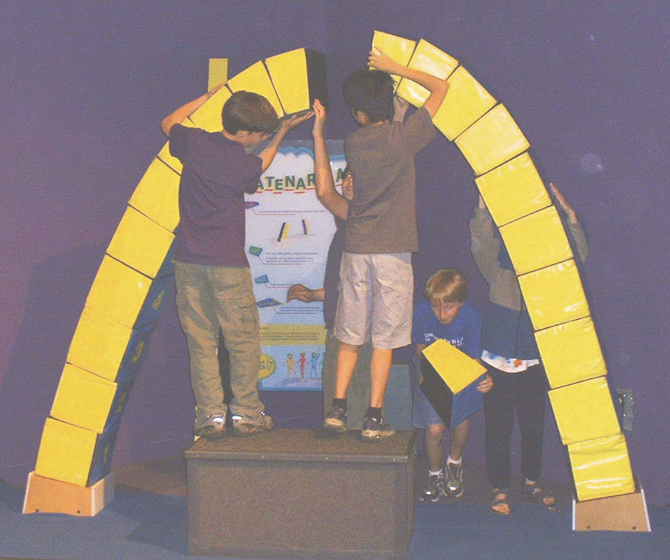 Photo by Mary Klein (2004). Pre-teens building an arch.