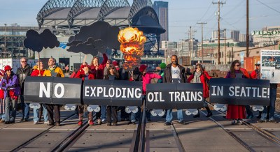 Demonstration on train tracks against oil trains, © Alex Garland Photography
