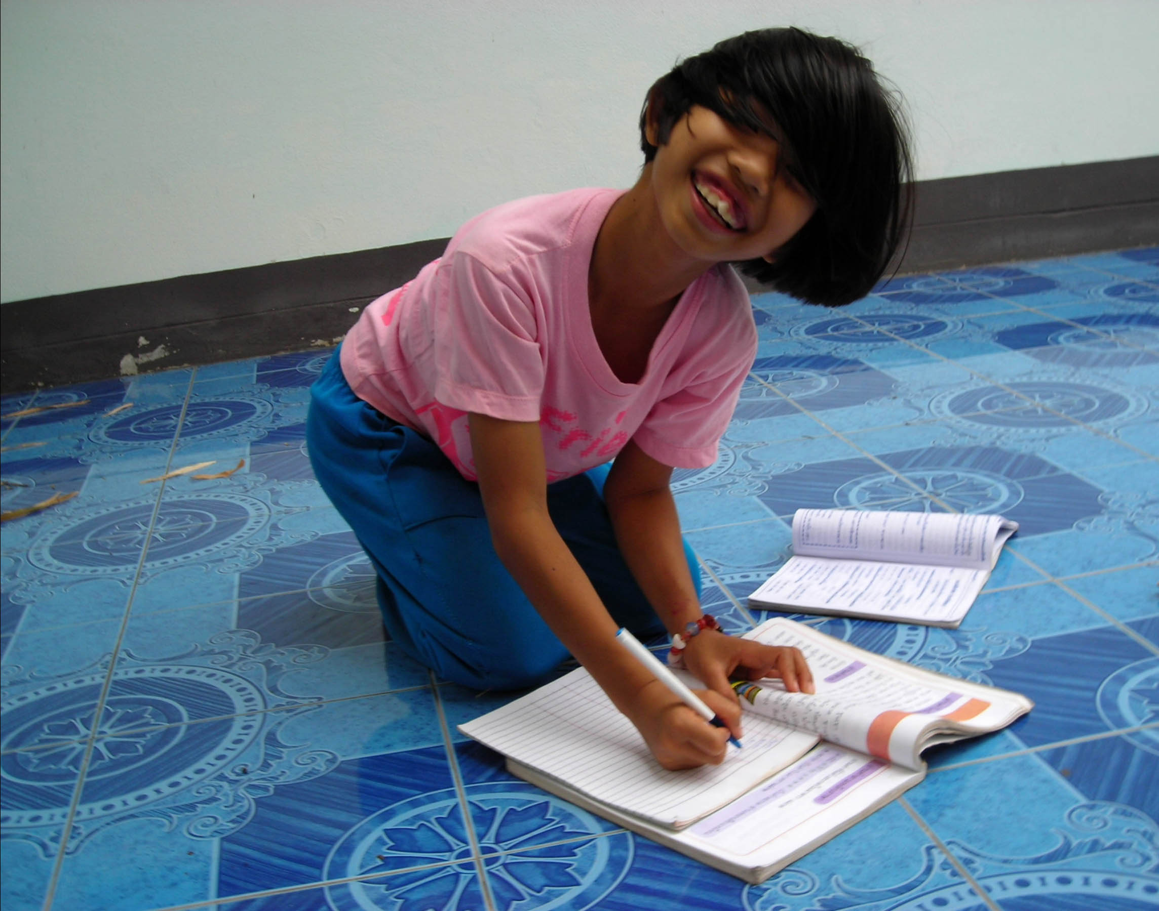 Tai pupil writing.jpg