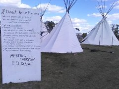 Nonviolence agreements poster by teepees - photo by Kyle Chandler-Isacksen