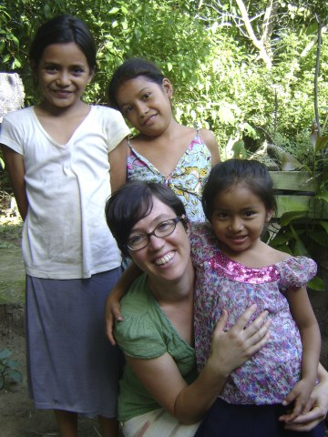 Image by PYM's Latin American Concerns Committee (2014). The author with Savadorean children. One of these children was detained at the US-Mexico border.