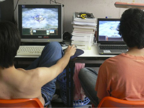 Two video gamers; photo by Love Krittaya (2007)