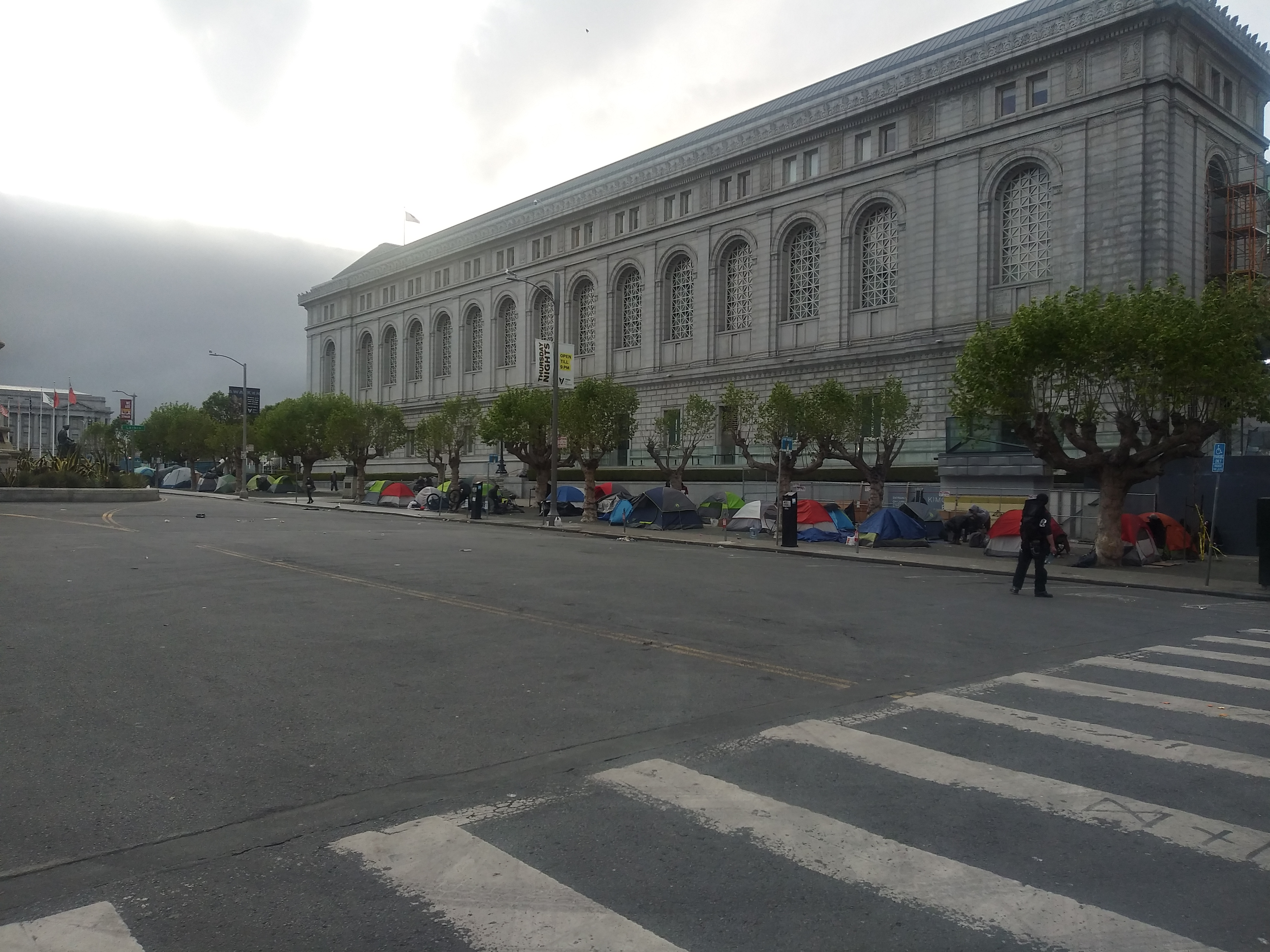 Photo of tents pitched on sidewalk of downtown San Francisco
