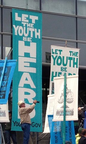 Banners at a youth-led climate-justice demonstration.
