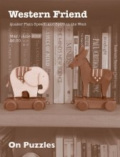 Magazine cover with image of wooden elephant and donkey