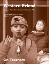 Magazine cover showing a boy speaking into a microphone