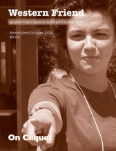 Cover of magazine showing young woman pointing